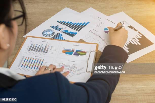 Businesswoman analyzes stock market