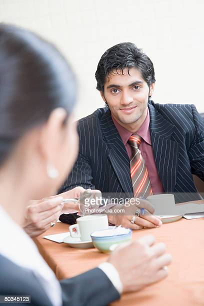 Businesswoman and a businessman discussing in a conference room