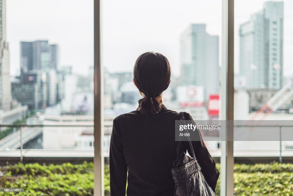 Businesswoman and big city : Stock Photo
