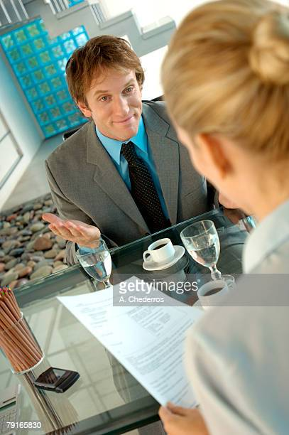 Businesswoman and business woman talking in office