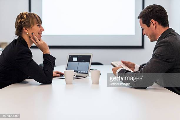 Businesswoman and businessman during meeting, Stockholm, Sweden