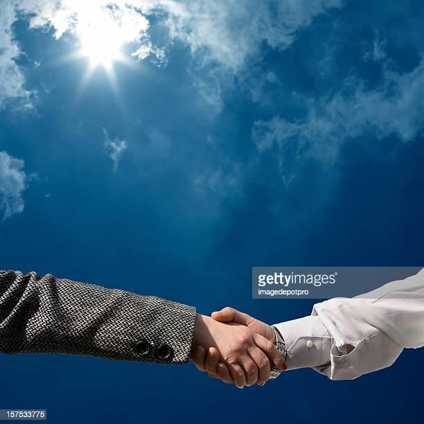 businesswoman and businessman handshake