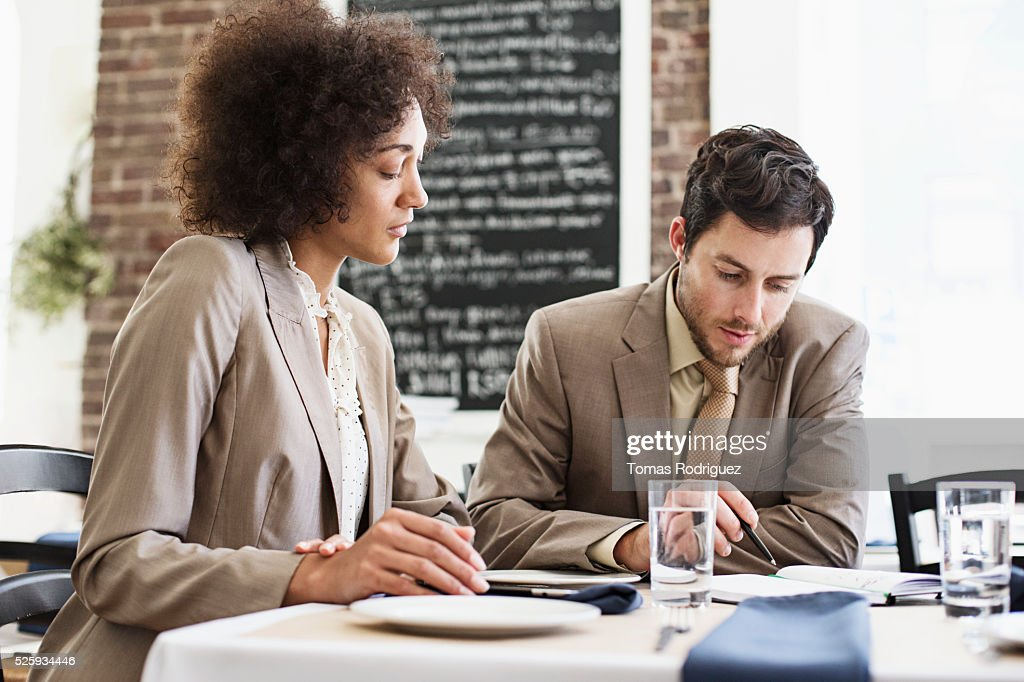 Businesswoman and businessman having meeting in restaurant : Bildbanksbilder