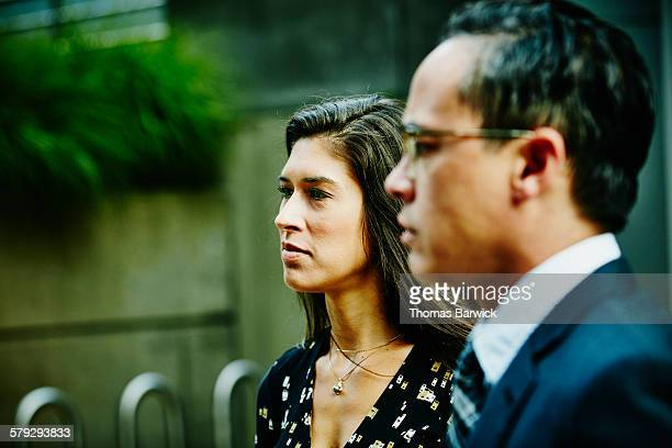 Businesswoman and businessman in discussion