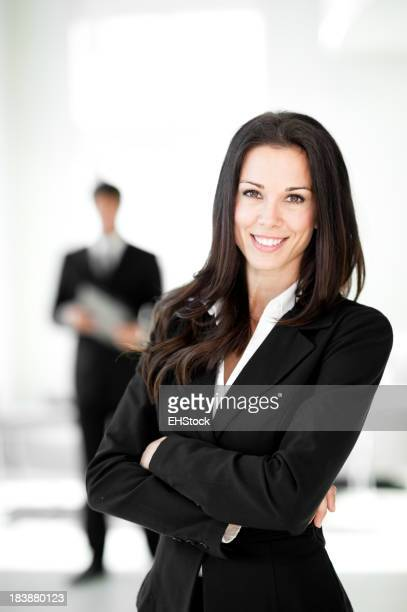 Businesswoman and Businessman in Lobby