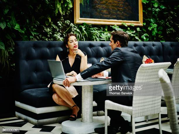 Businesswoman and businessman in lunch meeting