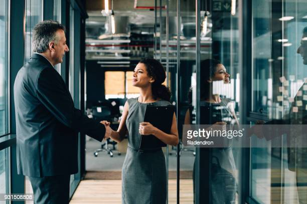 businesswoman and businessman shaking hands. - recruitment stock pictures, royalty-free photos & images