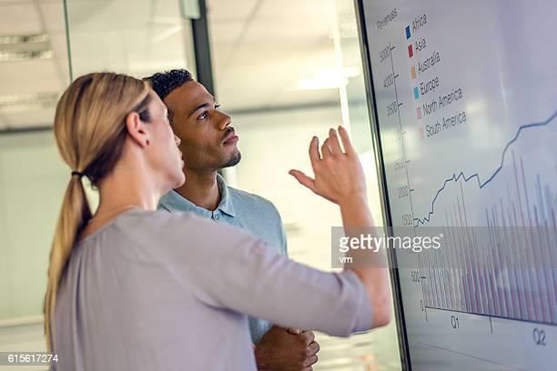 Businesswoman and businessman talking profit