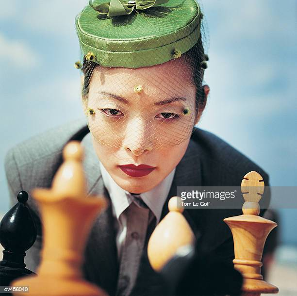 Businesswoman and chess pieces
