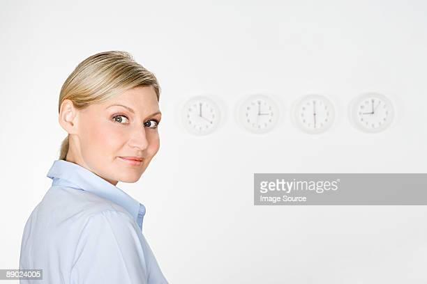 Businesswoman and clocks