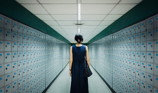 Businesswoman and data storage system - gettyimageskorea