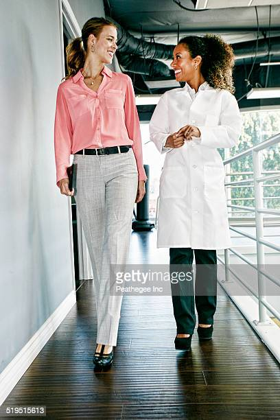 Businesswoman and doctor talking in corridor