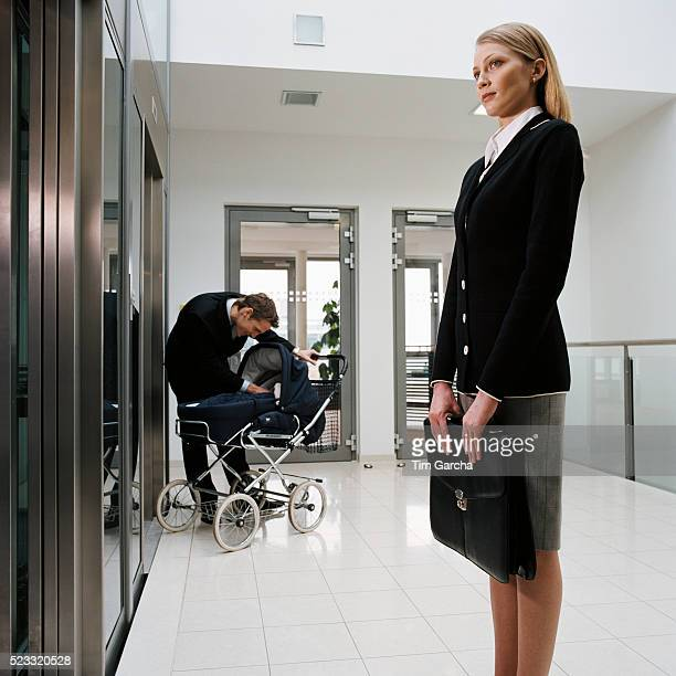 Businesswoman and Man with Baby Carriage