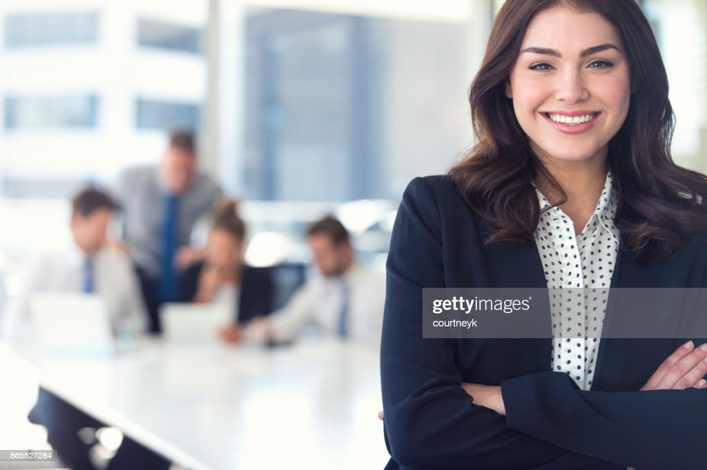 Businesswoman and team at the office. : Stock Photo