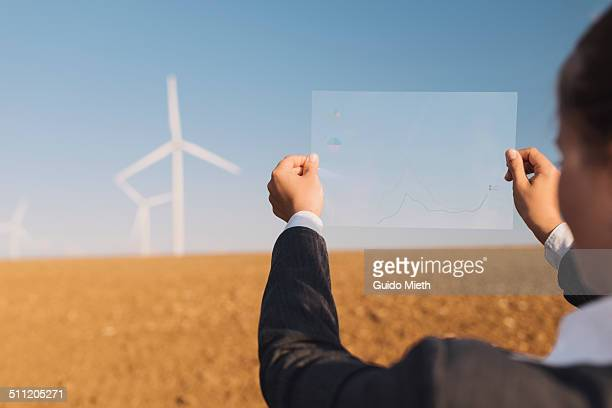 Businesswoman and wind turbine.