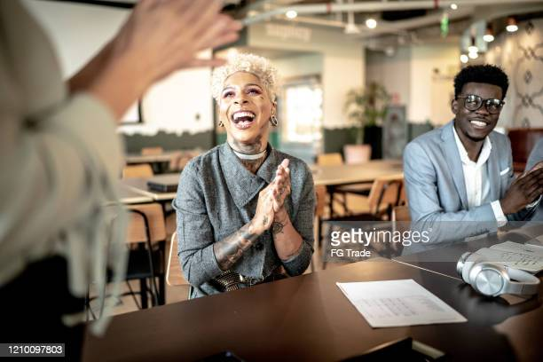 businesswoman applauding at business meeting - admiration stock pictures, royalty-free photos & images