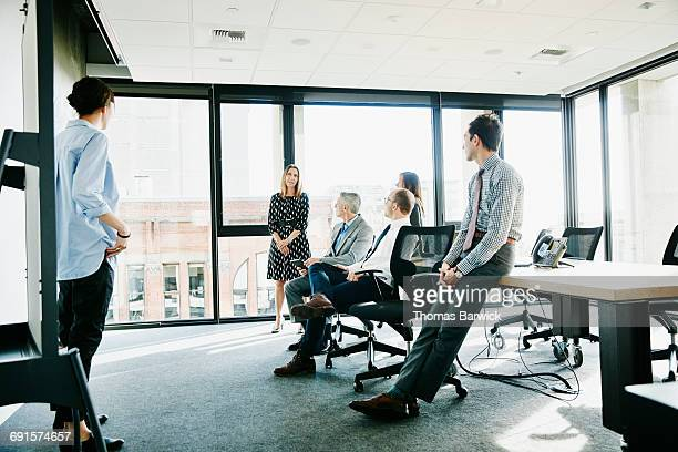 Businesswoman asking a question during meeting