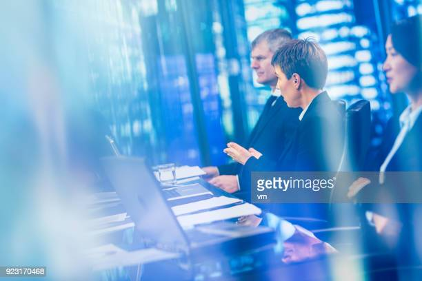 Businesswoman asking questions during meeting