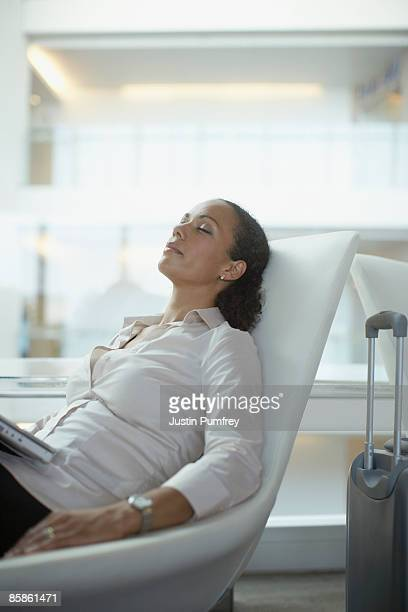 businesswoman asleep in chair - resting stock pictures, royalty-free photos & images