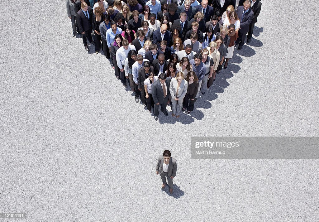 Businesswoman at apex of crowd : Stock Photo
