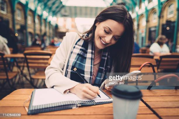 businesswoman at cafe working - learn english stock pictures, royalty-free photos & images