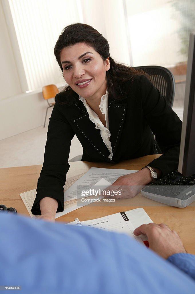 Businesswoman at desk in meeting : Stockfoto