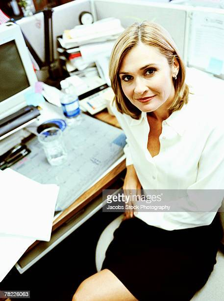 businesswoman at desk - down blouse stock photos and pictures