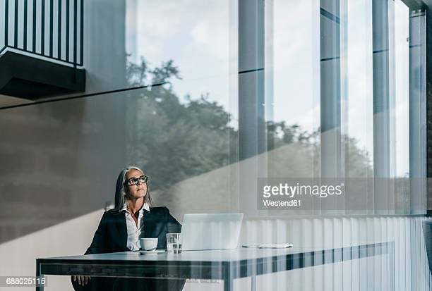 Businesswoman at desk with laptop