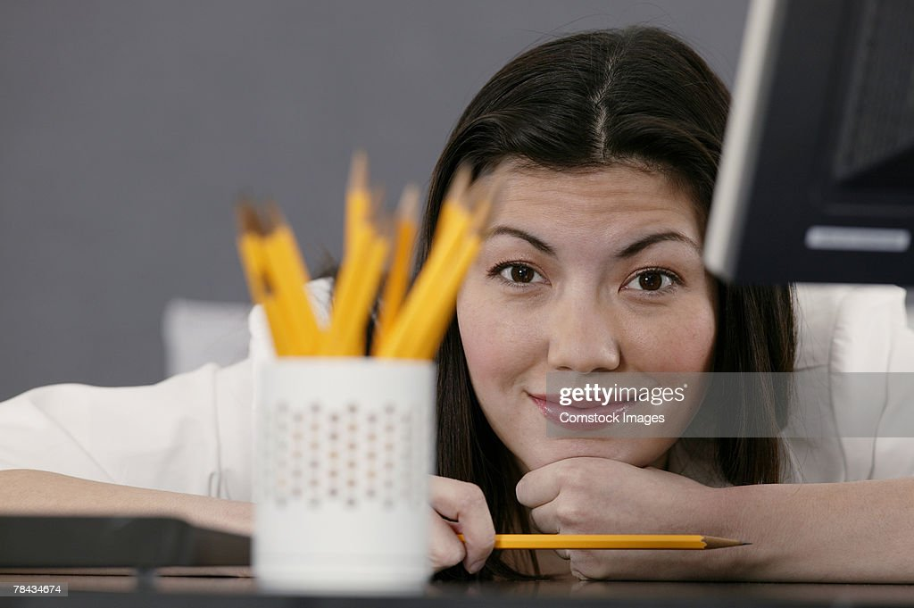 Businesswoman at desk with pencils : Stockfoto