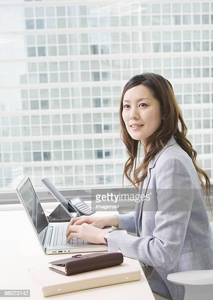 Businesswoman at desk working