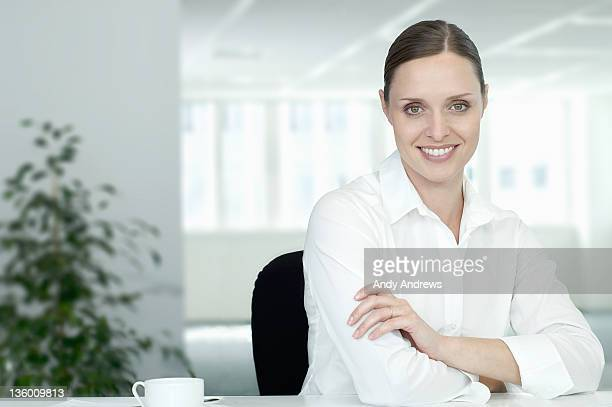 Businesswoman at her desk smiling