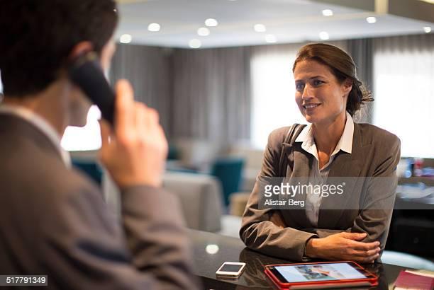 Businesswoman at hotel reception
