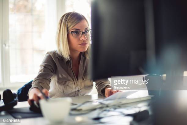 businesswoman at office - concentration stock pictures, royalty-free photos & images
