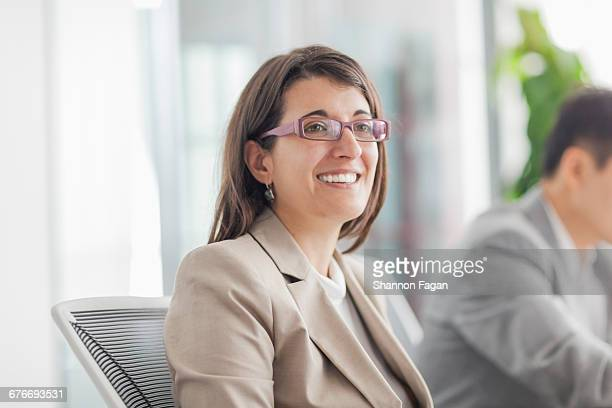 Businesswoman at team meeting in conference room