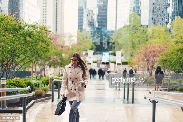businesswoman at the business park - business community stock pictures, royalty-free photos & images
