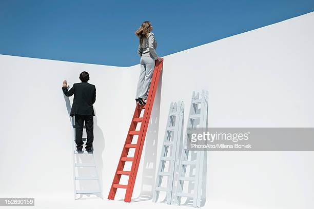 businesswoman at top of ladder - ladder stock pictures, royalty-free photos & images