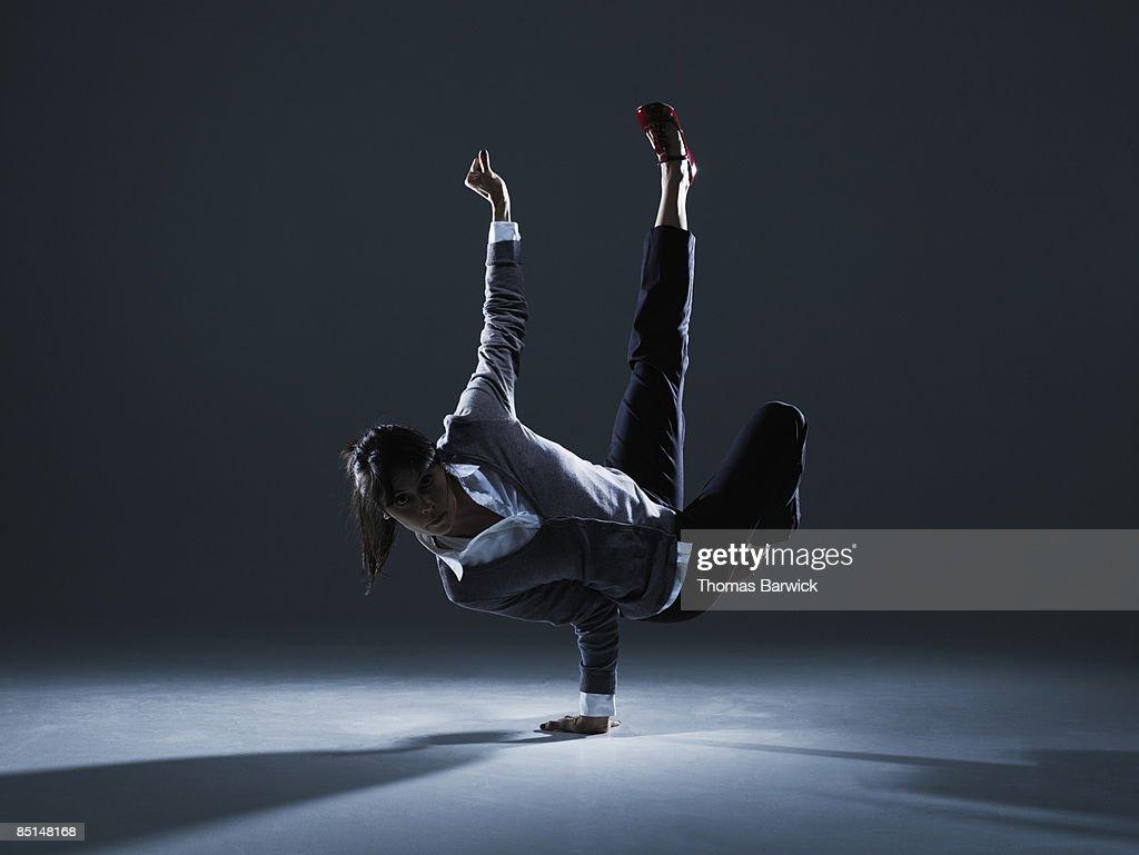 Businesswoman balancing on one hand : Stock Photo