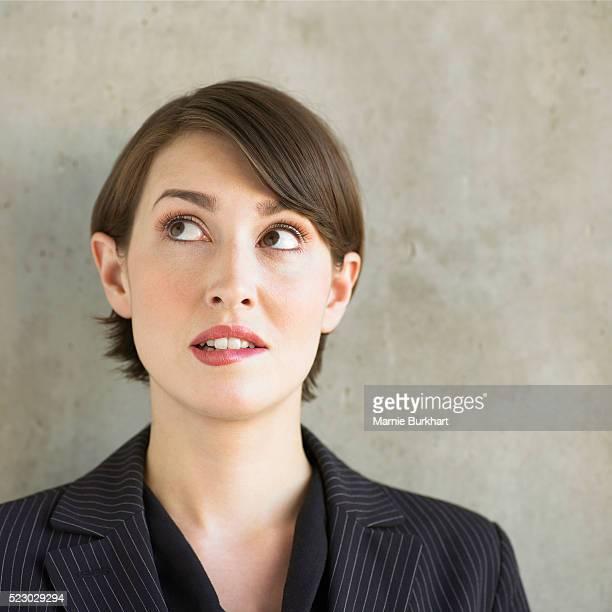 Businesswoman biting her lip