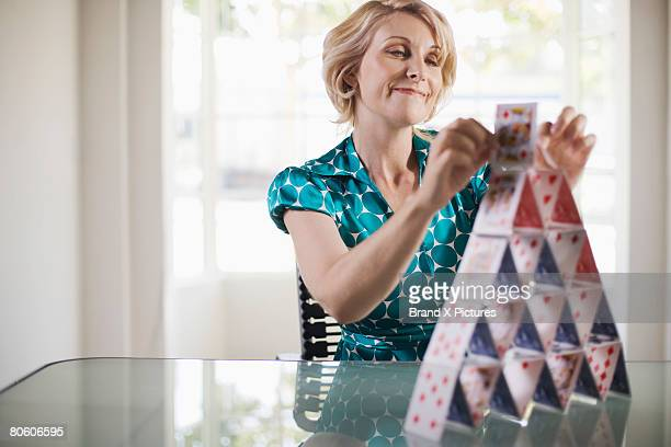 Businesswoman building house of cards