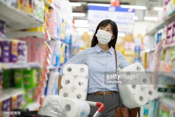 businesswoman buy paper towel - kitchen paper stock pictures, royalty-free photos & images