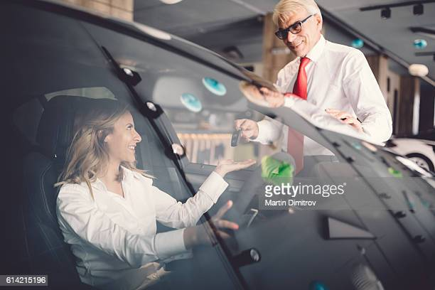 Businesswoman buying a new car