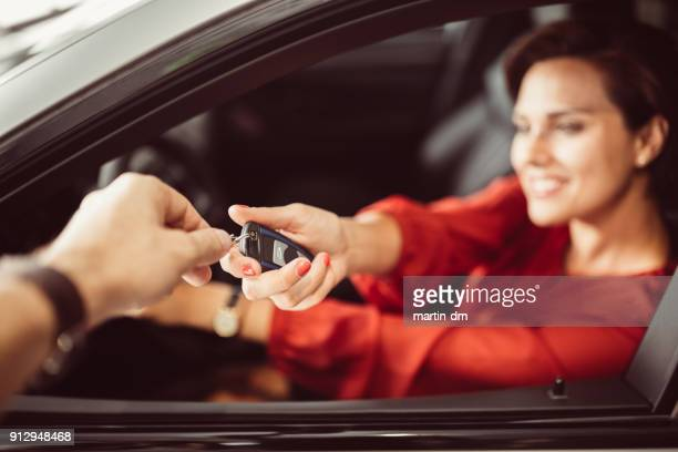 businesswoman buying car - car key stock pictures, royalty-free photos & images