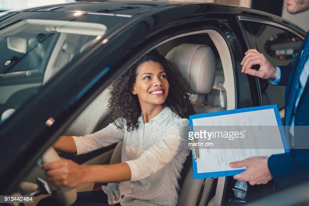 businesswoman buying new car - buying a car stock pictures, royalty-free photos & images