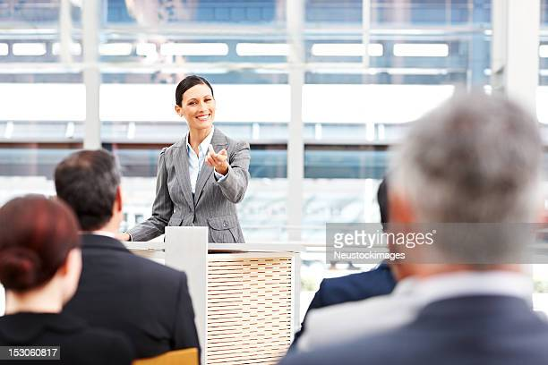Businesswoman Calling on an Audience Member