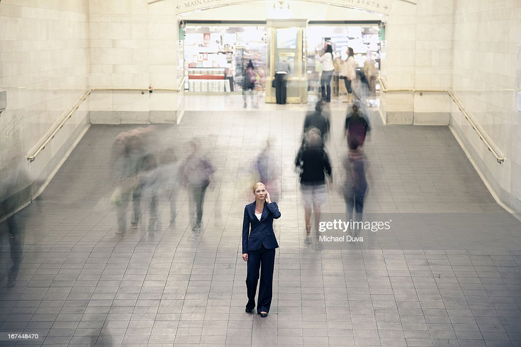businesswoman calling using her cell phone : Stock Photo