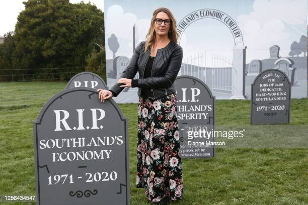 Businesswoman Carla Forbes poses for a photo in front of her graveyard display signifying the communities loss to Tiwai's closure at the entrance of...