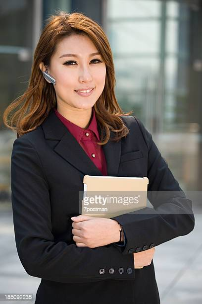 businesswoman carry tablet computer