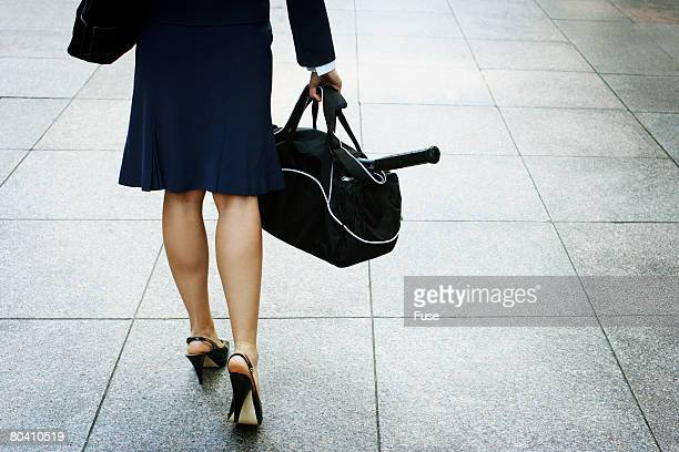 Businesswoman Carrying Gym Bag
