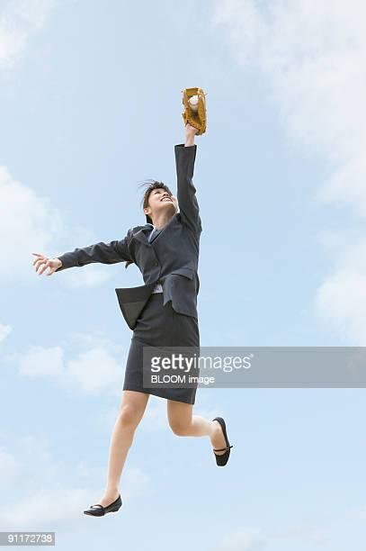businesswoman catching ball - つかまえる ストックフォトと画像