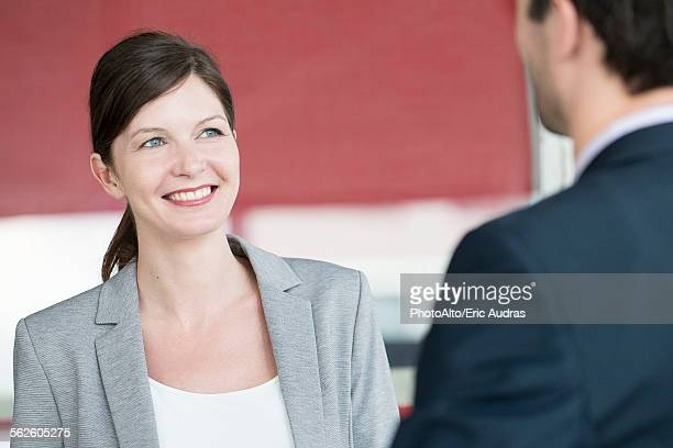 Businesswoman chatting with colleague